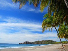 Carrillo Beach is an idyllic palm-tree-lined, white sandy beach in Costa Rica.