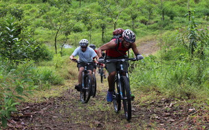 Mountain biking in arenal single track madness challenging private tour