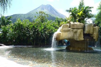 See the Arenal Volcano from Baldi Hot Springs in Costa Rica.