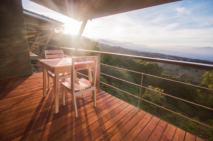 The stunning view from a Recibidor Suite balcony of a Costa Rican sunset over the valley