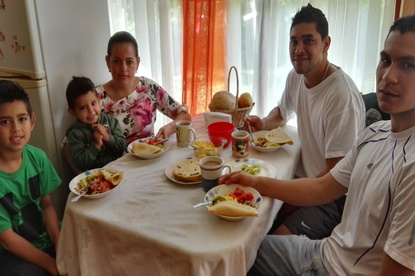 Maureen Jimenez and son enjoying a home-cooked breakfast with family members at Homestay Majim