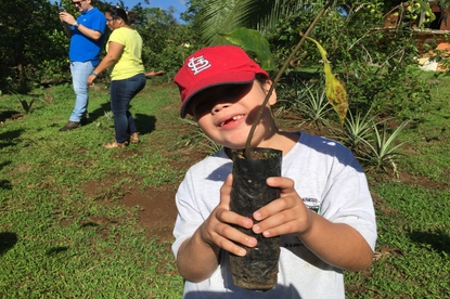 Even young children help with reforestation and planting trees in Costa Rica.