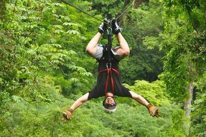 Ziplining with viewsof thebeach Jaco Costa Rica.