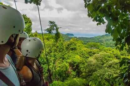 Ziplining with viewsof the beach Jaco Costa Rica.