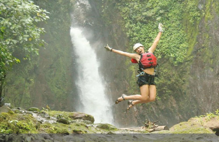 Adventures in wellness and transformational travel in Costa Rica girl jumping in Gravity Falls Desafio.