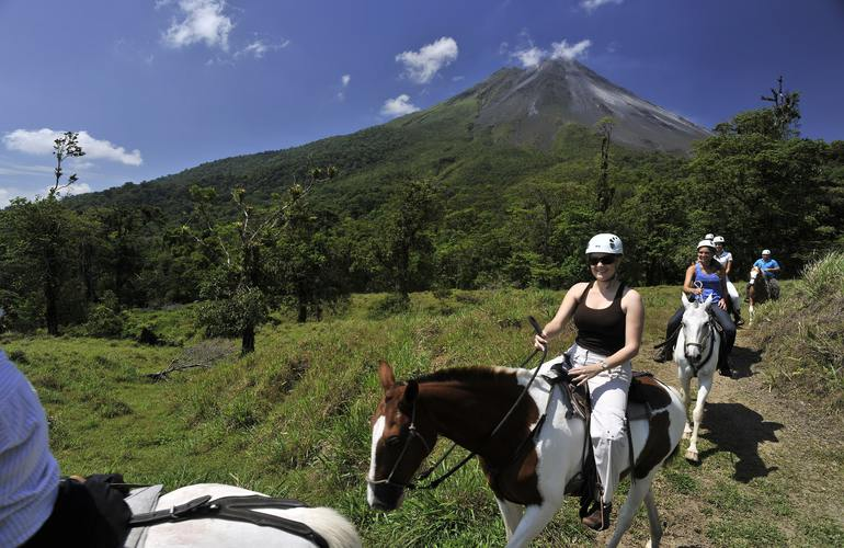 Horseback ride with the coolest views along the foothills of the Arenal Volcano.