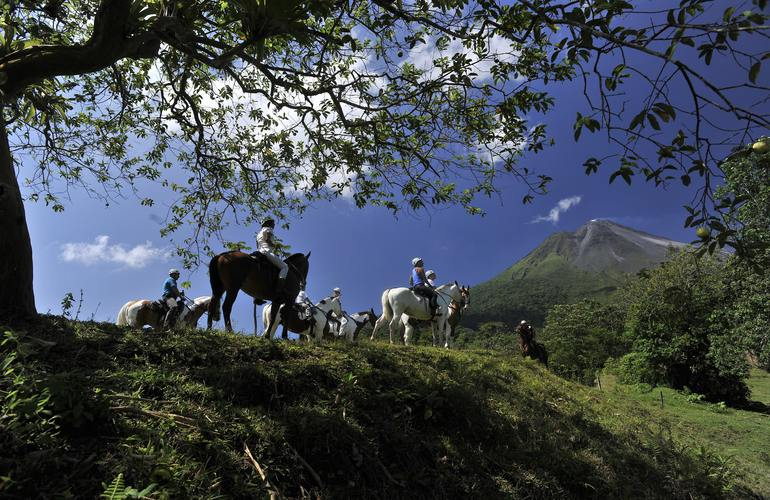 Get spectacular scenery on the horseback ride to the Arenal Volcano.
