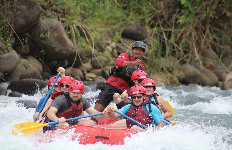 Having fun rafting in Costa Rica.