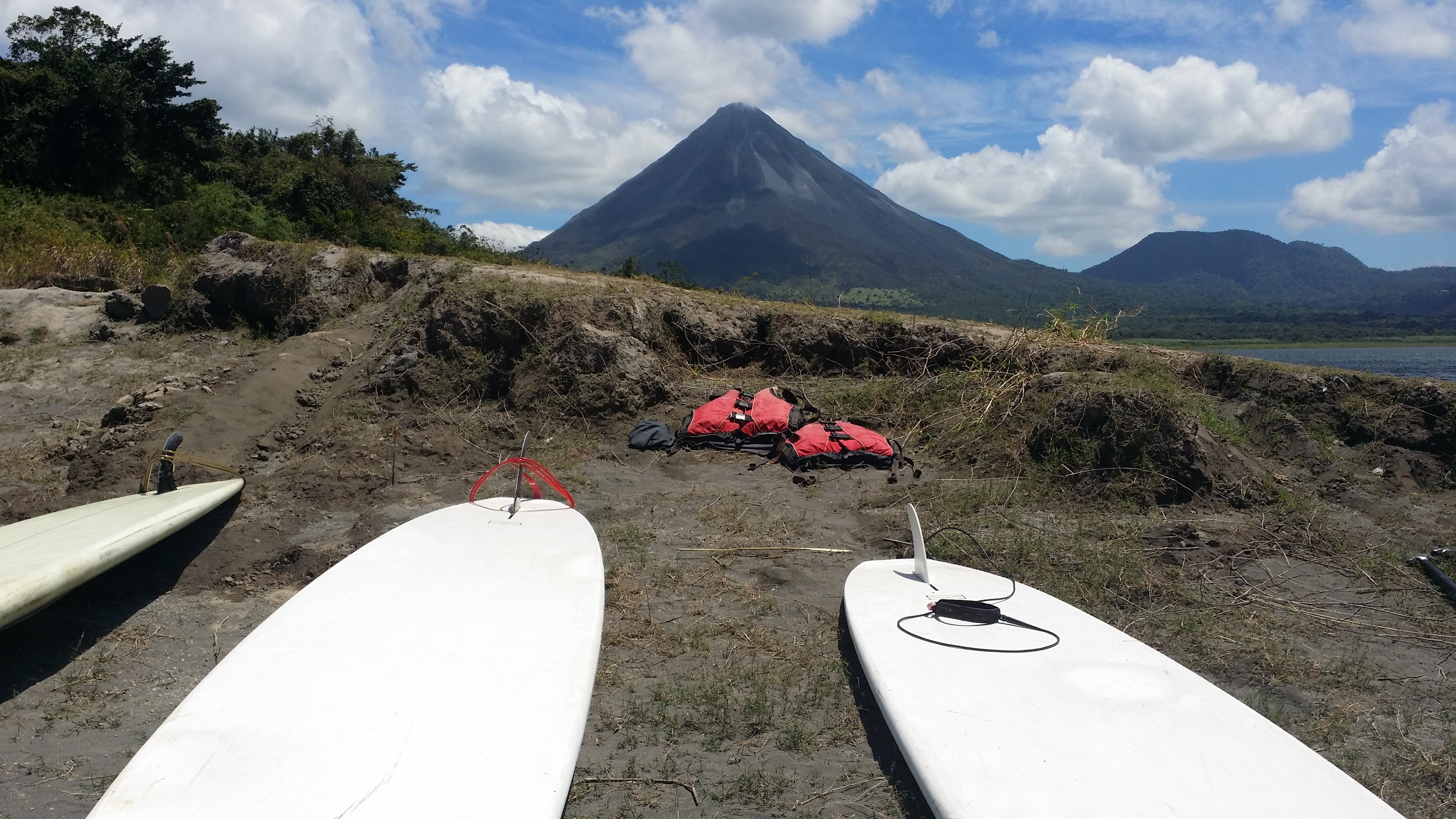 Getting the boards ready for Stand Up Paddling at the Arenal Volcano.