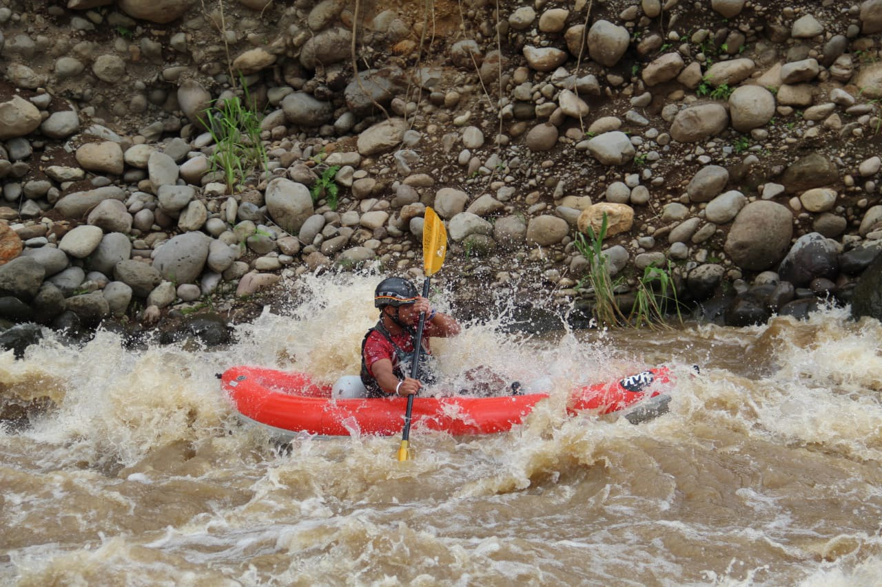 Safety first with kayakers on the Desafio Adventure Company Team Building Adventure Rafting in Costa Rica!