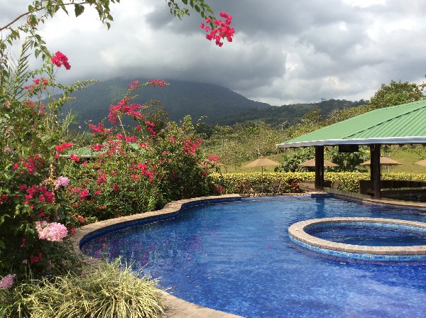 Beautiful pools and a volcano view at Arenal Manoa Resort and Hot Springs. Desafio can help you get all the best rates on hotels, transportation and adventures in Arenal and anywhere in Costa Rica!