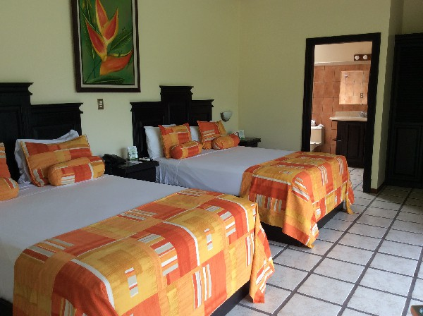 Spacious and comfortable rooms with volcano views at Arenal Manoa Resort and Hot Springs. Desafio can help you get all the best rates on hotels, transportation and adventures in Arenal and anywhere in Costa Rica!