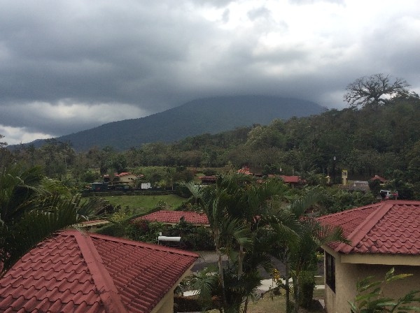 Standing on one of the guest room balconies overlooking the resort and the Arenal Volcano.