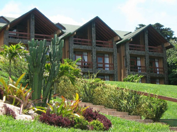 Beautiful and modern guest rooms feature private balconies and large windows at El Establo in Monteverde, Costa Rica.