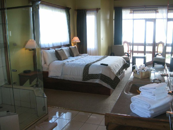 Spacious rooms feature ample bathrooms and private balconies at El Establo hotel.