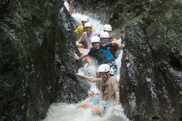 Having fun in the Lost Canyon while Canyoneering in Arenal, Costa Rica.