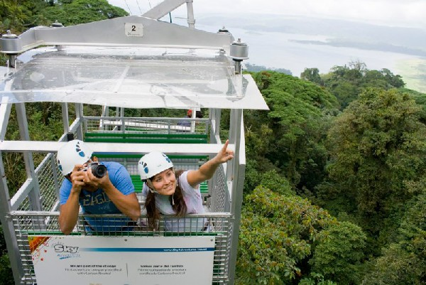Get the best views of the Arenal rainforest from Sky Adventures zip lining.
