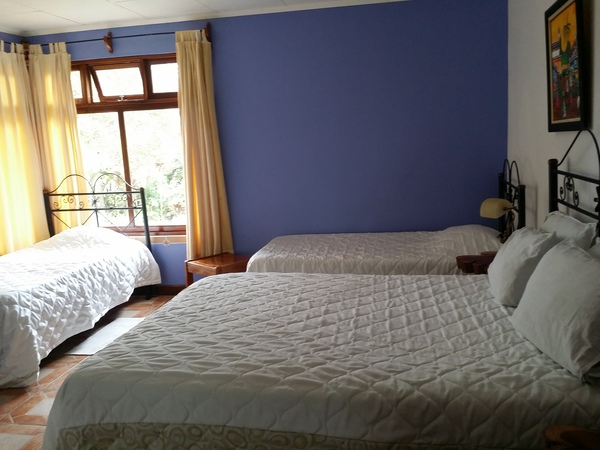The beautiful guest room at the Guayabo Lodge in Turrialba Costa Rica.