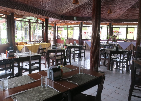 Ample dining room with a volcano view at La Pradera in La Fortuna, Arenal Costa Rica