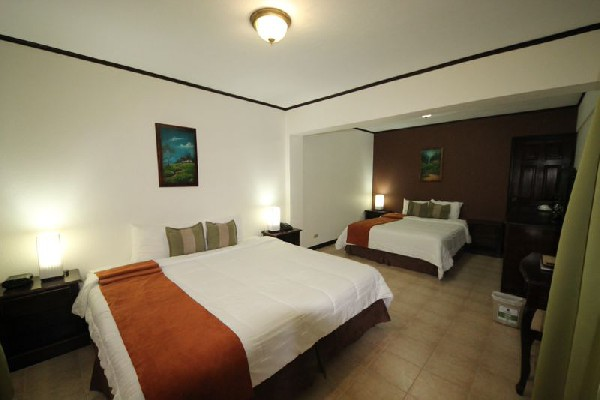 Spacious guest rooms and comfortable beds are great for resting after adventuring in Monteverde!