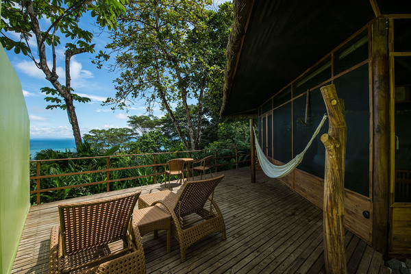 Private balconies with a view at Lapa Rios in the Osa Peninsula Costa Rica. Desafio can help you book this and other Costa Rica luxury resorts.
