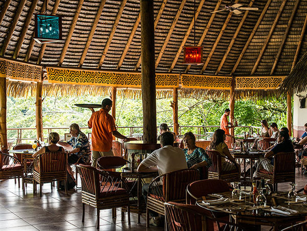 Open air dining at Lapa Rios in the Osa Peninsula Costa Rica. Desafio can help you book all of your hotels, tours and transportation in Costa Rica.