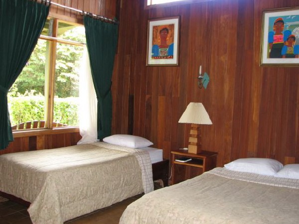 Clean, simple and comfortable bedrooms at Monteverde Cloud Forest Lodge.