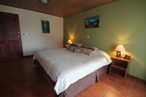 Spacious rooms, spanish tiles and comfortable beds are features of the Superior Rooms at Monteverde Country Lodge.