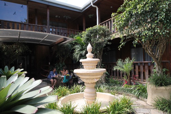 Fountains and immaculate gardens with seating areas are featured through the property at Monteverde Country Lodge.