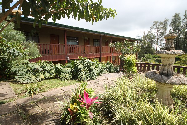 Tropical gardens surround the rooms at Monteverde Country Lodge.