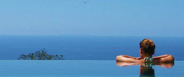 Relaxing in the infinity pool at the Oxygen Jungle Villas in Costa Rica.