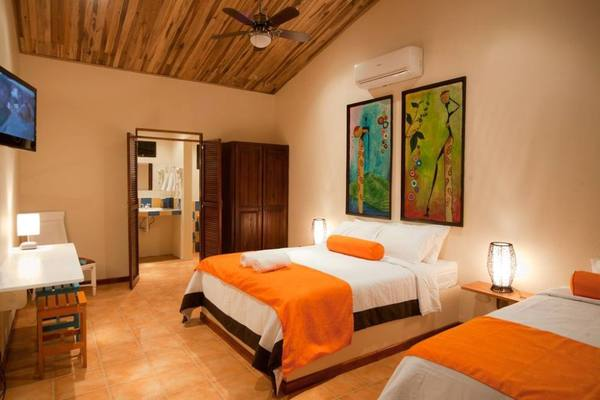 Spacious and bright rooms at Hotel Pasatiempo in Tamarindo is an affordable options for couples or families visiting the beach in Costa Rica. Desafio can help you plan the best Costa Rica vacation!