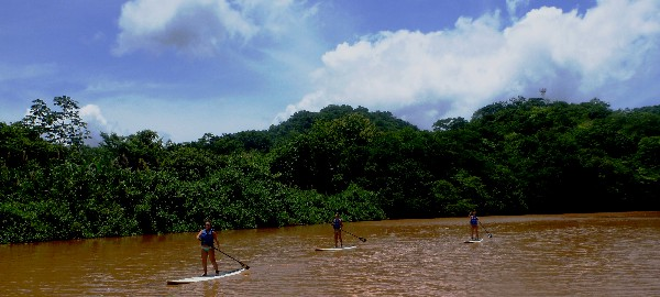 The river ends at the untouched, dark sand beach of Camaronal