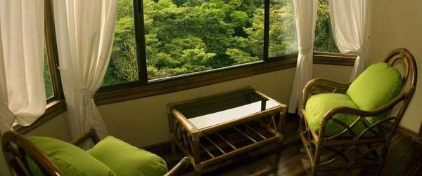 Rooms feature sitting areas surrounded by windows to enjoy the natural surroundings.