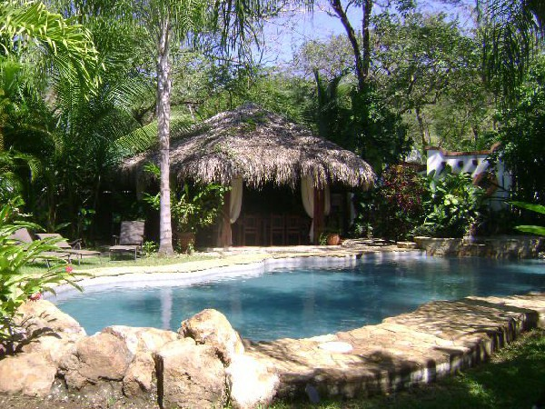 Beautiful gardens and a relaxing pool for guests at Villa Kalimba in Playa Samara. Desafio can help you plan an affordable Costa Rica vacation!