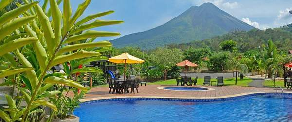Impressive volcano views from the pool and hot springs at Volcano Lodge & Springs in La Fortuna, Costa Rica. As a partner hotel to Desafio, we can get you the best deal on hotels and your entire Costa Rica vacation!