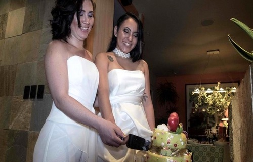 A happy lesbian couple ties the knot in Costa Rica after same-sex marriage becomes legal