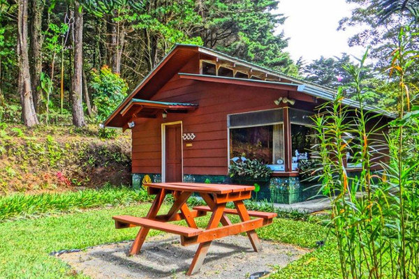 Each private cabin features picnic areas as well as garden and cloud forest views at Los Pinos in Monteverde.