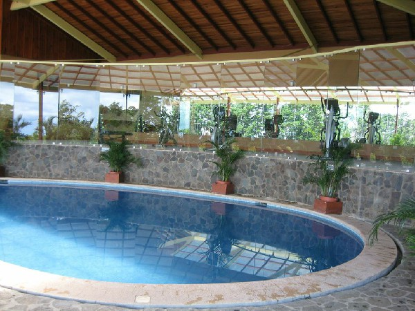 Covered heated swimming pool at El Establo is the perfect way to unwind after a long day of adventures in Monteverde.