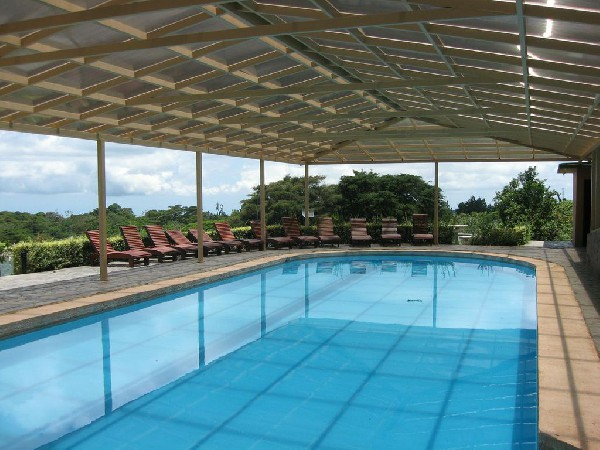 The covered heated swimming pool at El Establo is the perfect way to unwind after a long day of adventures in Monteverde.
