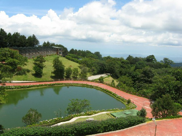 Overlooking the picturesque pond and beautiful view of the Monteverde mountains at El Establo hotel in Monteverde.