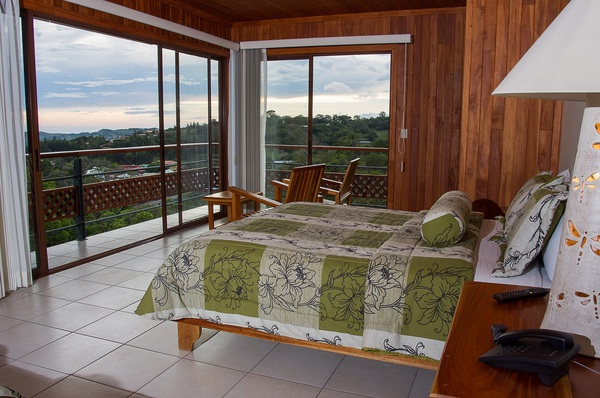 Stunning views of the surrounding cloud forest from your spacious room at Ficus Sunset Lodge in Monteverde.
