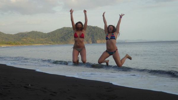 Happy girls on Samara Beach, Costa Rica.