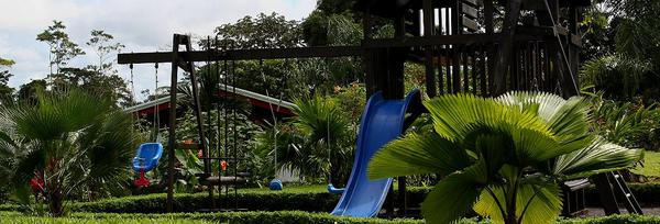 Kids play area in the gardens at Volcano Lodge & Springs in La Fortuna, Costa Rica. Desafio can help you book your hotel and provide all of your tours and transportation in Costa Rica.