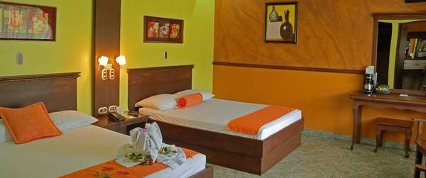 Modern rooms with rustic touches and lots of features at Volcano Lodge & Springs in La Fortuna, Costa Rica. Desafio can custom make your entire vacation to Costa Rica!