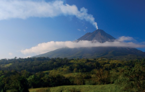 The Arenal Volcano slumbers above the tiny town of La Fortuna